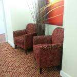 sitting area in the room hallway by elevators