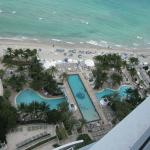 View of pools and beach from room balcony - kids pool crosses over long pool below
