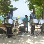 Steel drum band playing during beach barbecue