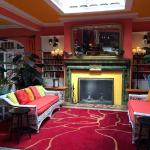 lobby with fireplace and built in book cases