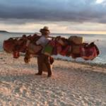 Beach hawkers selling baskets