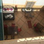 Looking down from roof terrace into courtyard where breakfast is served