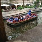 One of the many tour boats going along the Riverwalk.