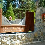 Anita poses near the Kings Canyon Welcome Sign. The Lodge is centrally located ...both Parks!