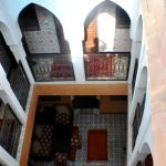 Natural light filters through the tall ceiling of the riad