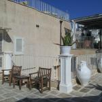 Our terrace with breakfast area in background