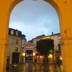 The Hôtel Cheval Rouge in Versailles on a rainy evening, viewed from the market.