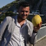 Our Guide holding a giant 'lemon'