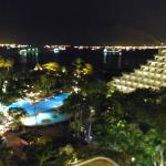By night, view to the pool and beach