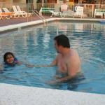 fifi and daddy swimming in the pool