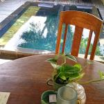 Scenes from Komaneka at Monkey Forest: bed on arrival, breakfast, rose petals in the bath and th