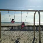 Swings on the beach.