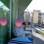 Chill time on balcony. (head blanked for trip advisor)