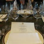Elegant Riedel glassware and custom dinner-pairing menu