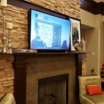Stacked Stone TV area in Breakfast Area / Lounging Area