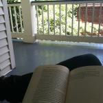 Reading on the porch outside our room