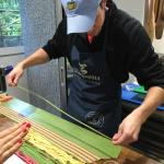 Me helping layer the tri-colored pasta used to make our ravioli.