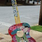 Decorated guitars like this are scattered around Tupelo