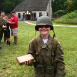 wearing field jacket steel helmet and holding some C-rations circa WWII