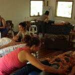 Bodywork therapists from around Costa Rica practice their CranioSacral therapy skills.