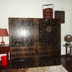 A very ornate Chinese wardrobe in bedroom of Transfer 1