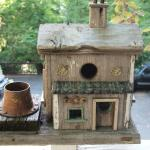 One of the many birdhouses on the porch and deck.