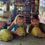 Enjoying coconut water with Franco after visiting Nuayaca Waterfalls