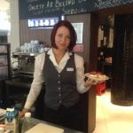 This is Linda,she is a barista with the hotel. She is professional, courteous, and speaks Englis