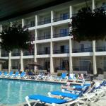The pool area is great for sitting with a drink or a book. It also has a small hot tub at one en