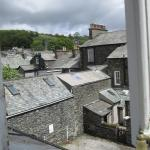 The view from our bedroom window out over the slate roofs to the distant hills.