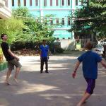 My boys out the front playing a game with the tuk tuk drivers