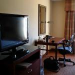Entertainment area and desk in suite