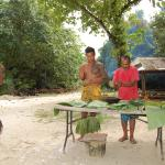traditional cooking with coconut beach staff