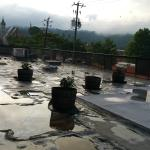 View across the first floor roof from 2nd floor room after the rain.