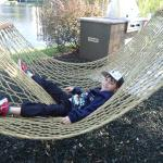 My son enjoying the hammock out by the beautiful Bella lake!