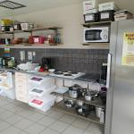 "One of the smaller kitchens. There are at least 3. Great for cooking and they have ""free"" bins."