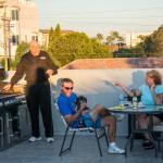 Our rooftop sundeck now has a bar and another new grill