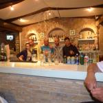Yanis the barman who likes to see everyone enjoy a drink and a good time.