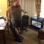 Me vacuuming the hotel's mess.