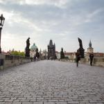 Visit the Charles Bridge before breakfast to escape the crowds.