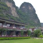The Hotel at the feet of the mountain, with a clean garden