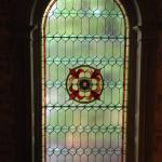 Stained glass window over stairway