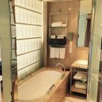 Bathroom with tub and private shower