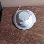 White noise machine on bedside table