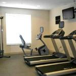 A fine fitness room with treadmills, cycle, weights, and pilates