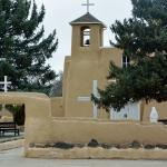 Pretty Adobe Church backs up to Ranchos Plaza, Taos, NM