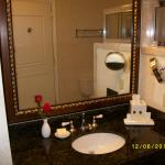 Granite counter top with makeup mirror and fresh rose each day.