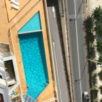 View of the hotel's swimming pool from the room's balcony