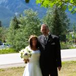 Picture of the bride & groom with the mountains in the background