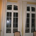 French doors opening onto the Balcony of stained glass